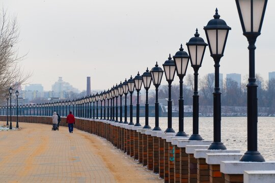 lanterns on the embankment in the winter in the evening