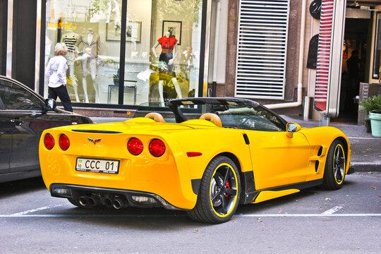 Kiev, Ukraine - August 6, 2011: Yellow American supercar Chevrolet Corvette C6 Z06 Convertible parked in the city