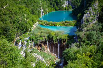 Wall Mural - Top view of Plitvice Lakes with waterfalls and surrounding forest