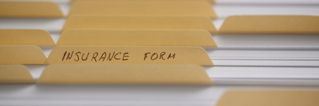 Office file cabinet full of many files with insurance form. Database, administration and file management concept