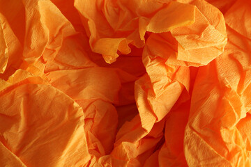 Orange textured material as background, closeup view