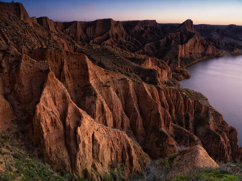 Burujon Canyon are spectacular clay cut that have been formed by wind erosion and the Tagus river, inside the reservoir Castrejon, which affords greater beauty to this place and becomes a refuge for many species of birds, Toledo, Castile La Mancha, Spain.
