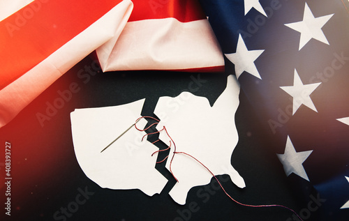 torn map of America USA is sewn back together as a symbol of healing and unite after problems crisis and chaos of division in country
