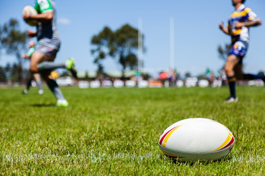 Rugby ball on with edge of the playing field during a game