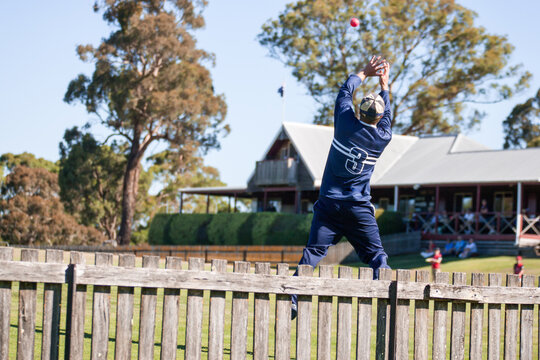 Fielder about to take a catch in a T20 cricket match