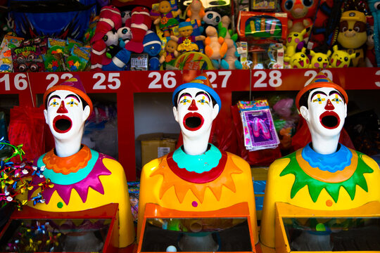 Laughing clowns at the side show at the Young Cherry Festival