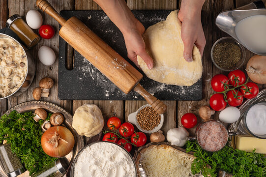 The chef prepares and works with the dough making italian pizza or pasta. Cooking Ingredients Top View Cooking Cooking Concept and Recipe Book