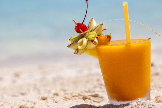 Fresh mango margarita cocktail on the beach