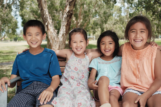 Happy multicultural young children at park