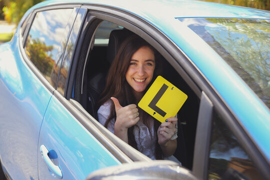 Teenage girl holding L plate