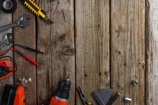 tools for work, screwdriver wrenches for nuts, knife on a wooden background top view