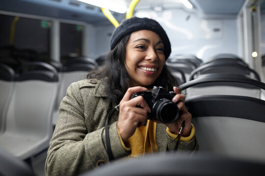woman taking photos in a public transportation