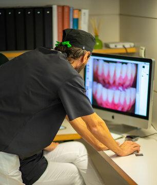 Dentist checking photos at Dental Clinic