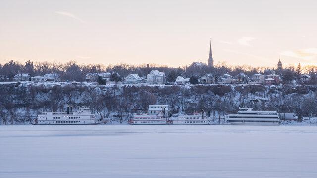 City of Stillwater Minnesota under sunset, including St. Michael's Catholic Church