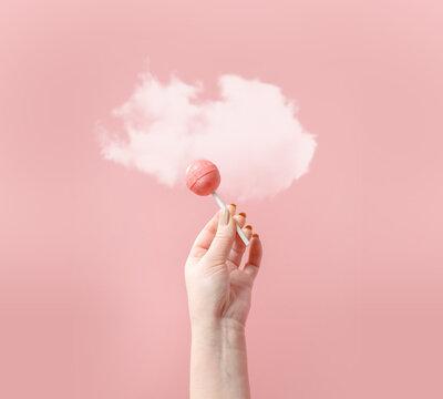 Creative composition lollipop on pastel background