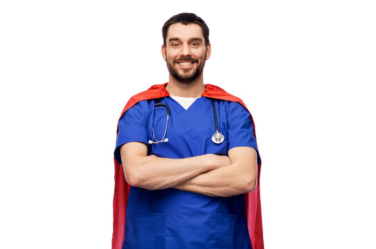 healthcare, profession and medicine concept - happy smiling doctor or male nurse in blue uniform and red superhero cape with stethoscope over white background