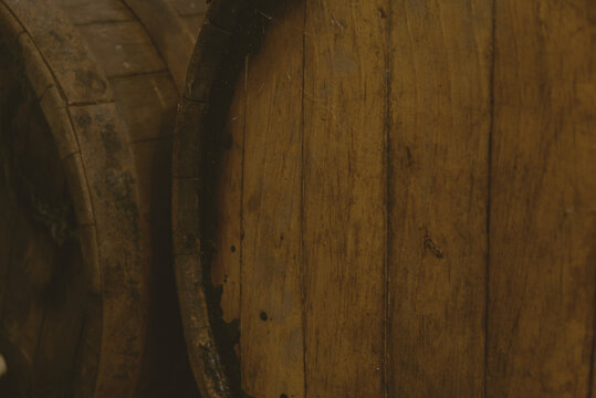 wine barrels on a wooden background