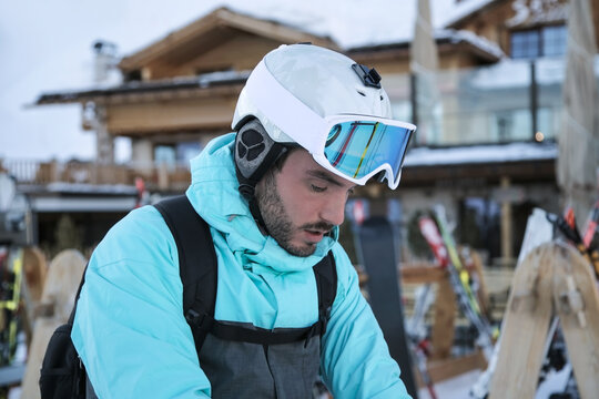 Handsome man with ski goggle in resort