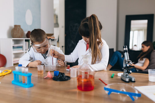children do chemical experiments from kitchen ingredients at home