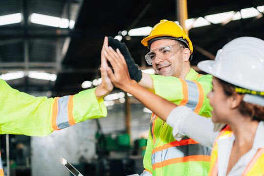 Teamwork and team spirit worker group give high five together corporate trust concept.industry celebrate reward success good teamwork result in factory