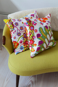 Floral cushions on retro sofa in living room