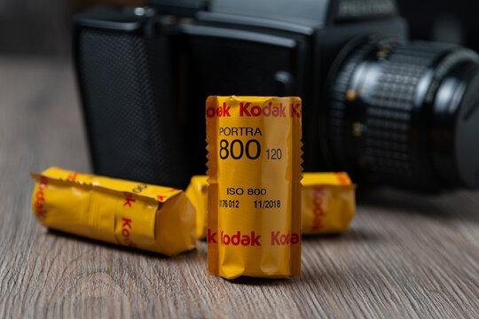 Different kodak Rolls of 120 film on a wooden table film photography concept. Kodak portra 800: Latvia, Riga, January 26, 2021