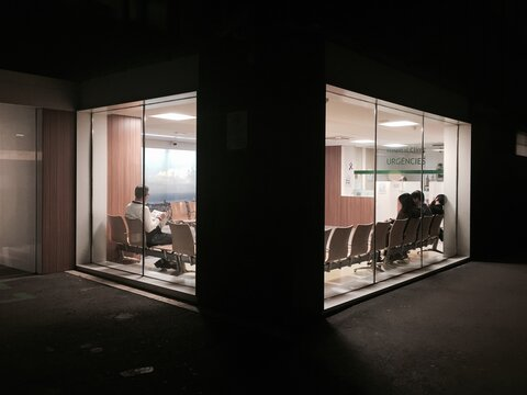 People Sitting In Waiting Area Of Hospital