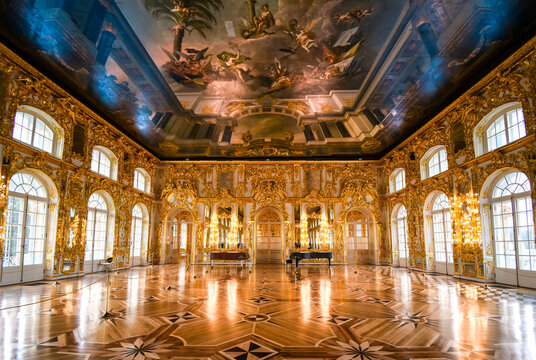 The ornate golden interior ballroom with a grand piano inside the Rococo Catherine Palace at Pushkin near St. Petersburg, Russia taken on September 21 2019.