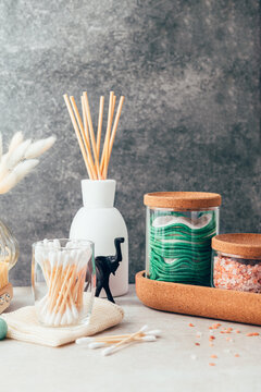Set of Eco Friendly Bath Items, such as bath salts, reusable cotton pads, diffuser, bamboo toothbrush, jade rollers, natural wooden brush, fresh soap, charcoal powder
