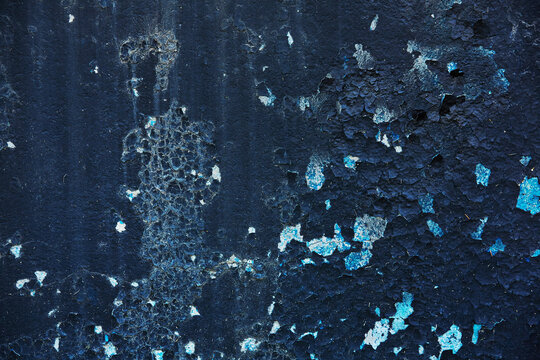 The texture of black cracked painted surface. Vintage old wall