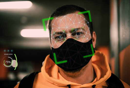 Man with face mask on face recognition software facial mask