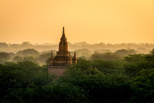 Pagoda against clear orange sky during sunrise, UNESCO, Bagan, Myanmar