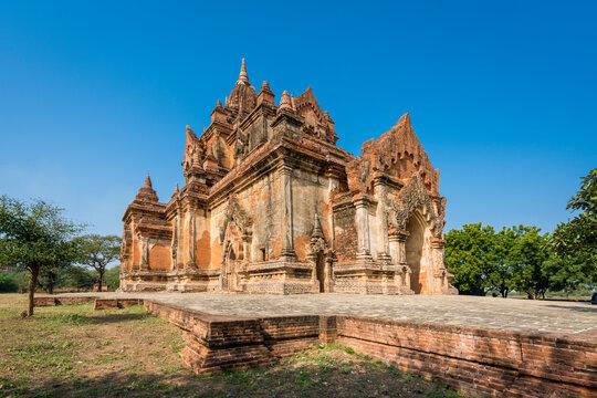 Exterior of historic temple against clear blue sky, UNESCO, Bagan, Myanmar