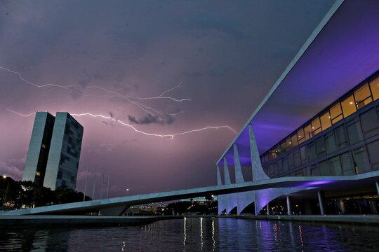 Lightning illuminates the sky above the National Congress and Planalto Palace in Brasilia