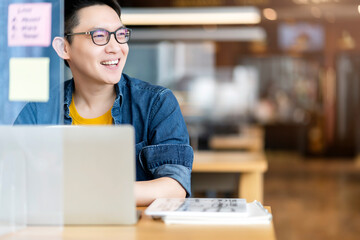Obraz Smart attractive positive asian business male wearing glasses work remote new normal lifestyle hand use laptop tele conference onlive videocall meeting remote business ideas concept - fototapety do salonu
