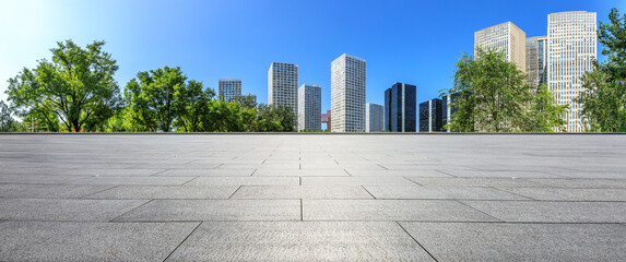 Empty square floor and modern city commercial buildings in Beijing,China.