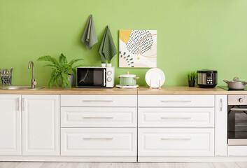 Obraz Stylish interior of comfortable kitchen - fototapety do salonu