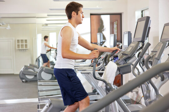 Young man working out at gym