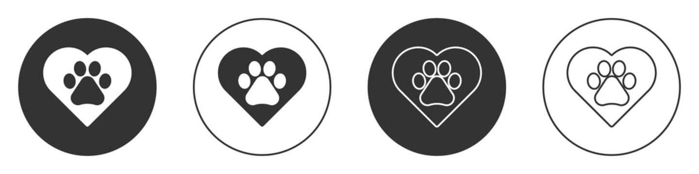 Black Heart with animals footprint icon isolated on white background. Pet paw in heart. Love to the animals. Circle button. Vector.