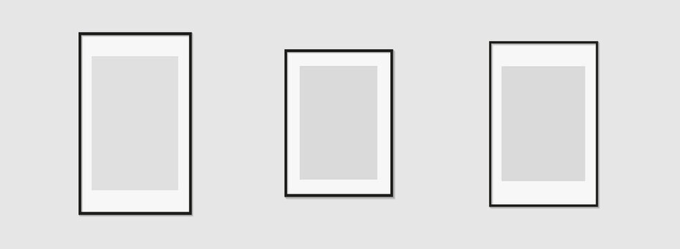 Set of black photo or picture frames with white mat and shades isolated on gray background. Vector illustration. Wall decor. Rectangle vertical photo frames