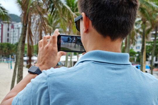 tourist taking shoot of Copacabana