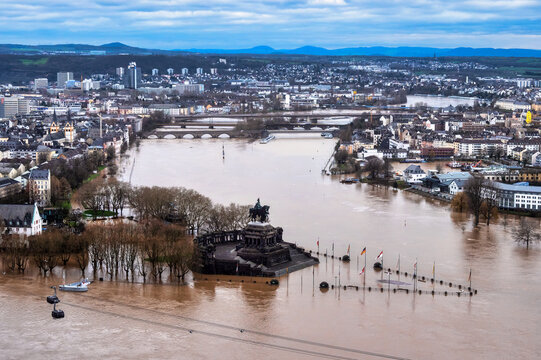 Flooding after heavy rainfall in Koblenz, Deutsches Eck. Koblenz is a German city on the banks of the Rhine and of the Moselle, a multi-nation tributary.
