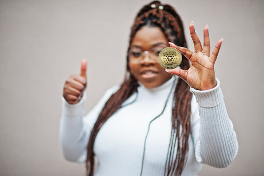 African american business woman show Cardano coin and thumb up. Cryptocurrency concept.