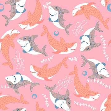 seamless pattern with cute smilling pink and blue baby sharks with leaves on pink background