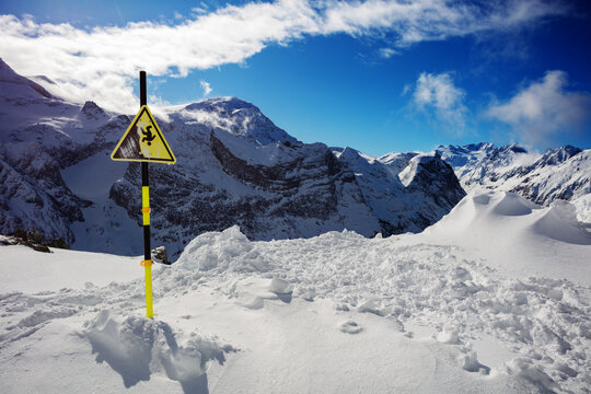 Fall warning sign from on mountain ski resort of Pralognan, French Alps