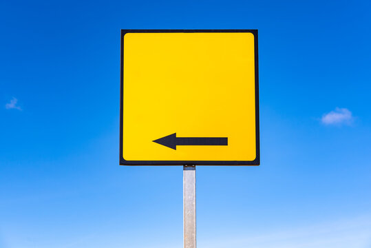 An empty square yellow traffic sign, with an arrow, to include text.