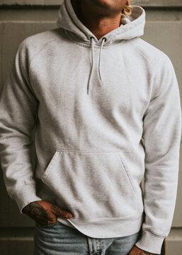 Alternative man in a white hoodie