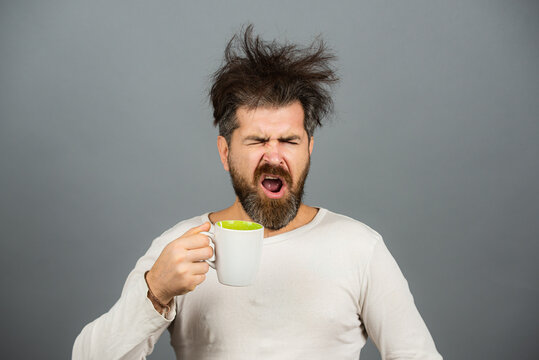 Man drinking coffee. Morning guy, wake up early in the morning on day, lifestyle daily concept. Sleepy shaggy guy in the morning.