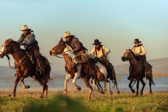 Cowboy riding a horse carrying a gun