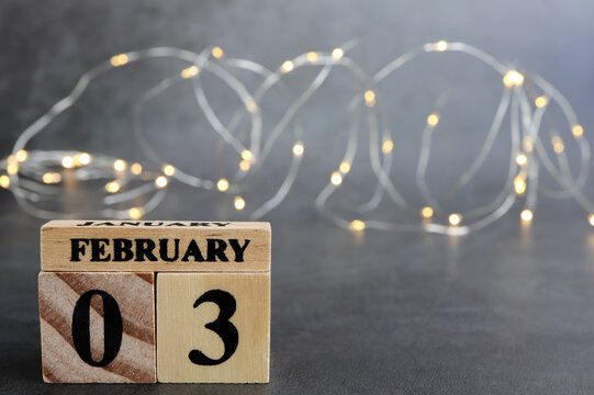 Day 3 of february month, Wooden calendar with date. Empty space for text.
